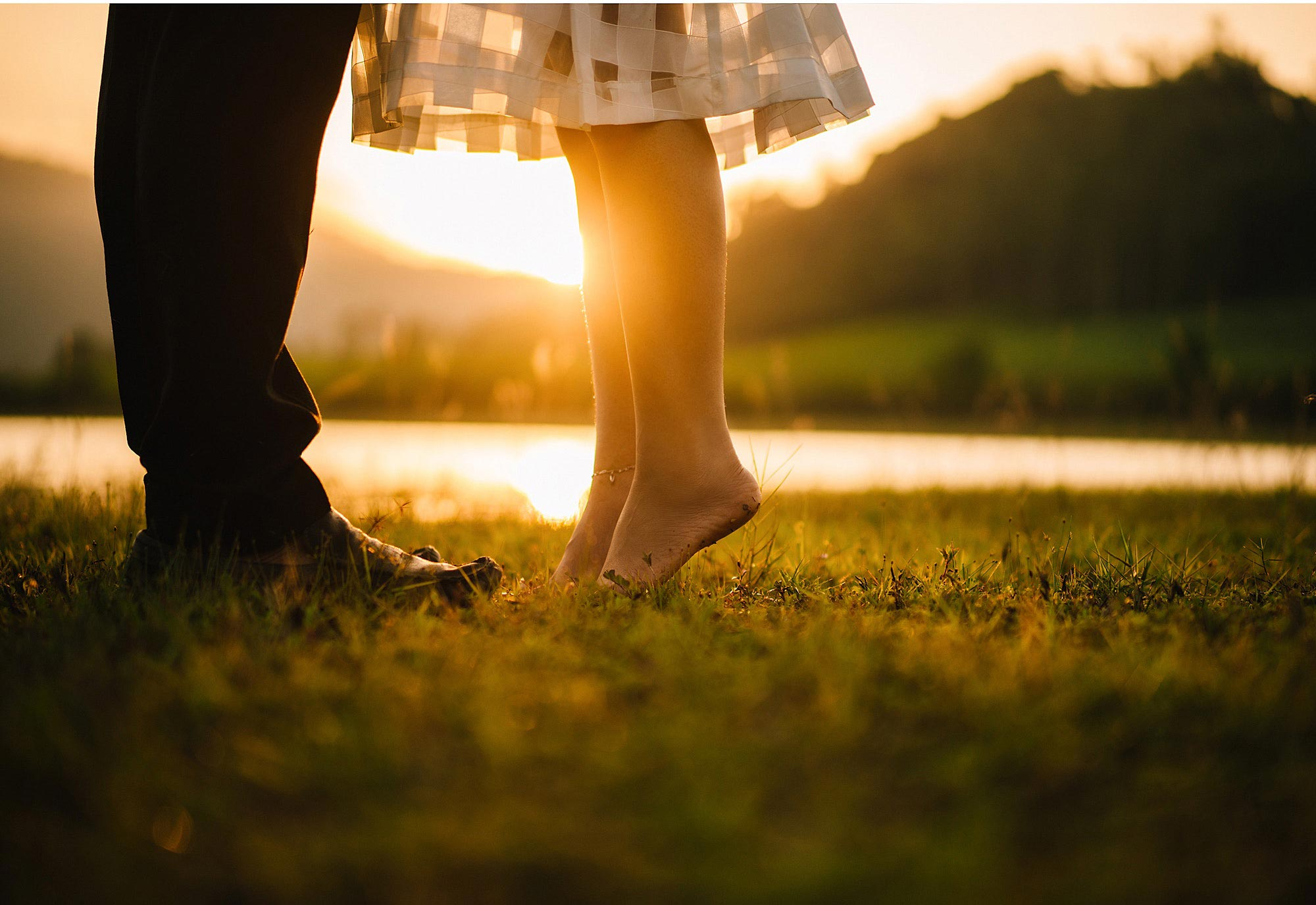 Couple's legs with sun shining. Couples counseling in Worthington & Columbus, OH area available at Blue Boat Counseling.43085