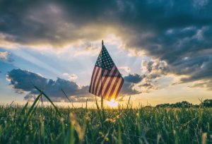American flag in the sun. Find PTSD treatment Columbus, OH for active military & veterans at Blue Boat Counseling, 43085.