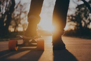 Teen boy's feet on skateboard. Find teen counseling in Columbus, OH for teen depression & anxiety at Blue Boat Counseling.