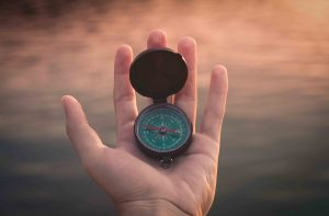 Hand with compass in it. Columbus depression treatment & therapy available at Blue Boat Counseling, Worthington, OH 43085.