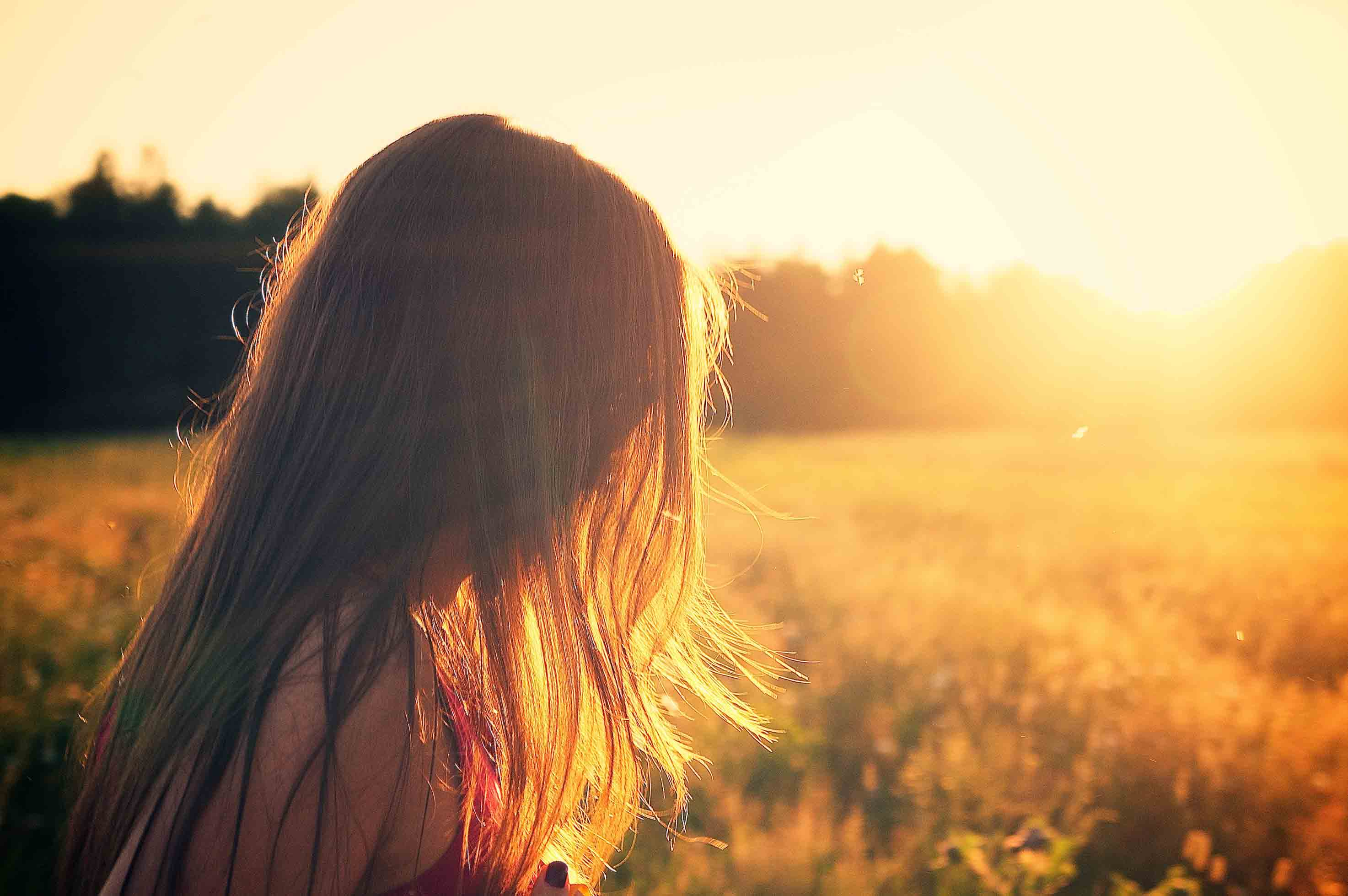 Profile of girl with long hair in sunshine. Depression counseling in Columbus, Ohio is available at Blue Boat Counseling.