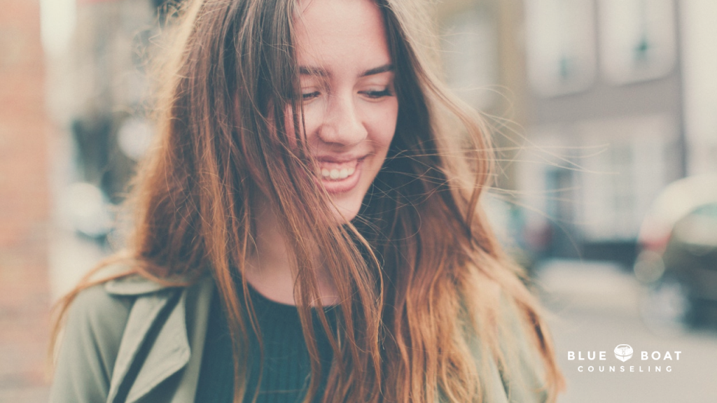 Girl with long hair smiling. Depression counseling in Columbus, Ohio available at Blue Boat Counseling, Worthington 43085.