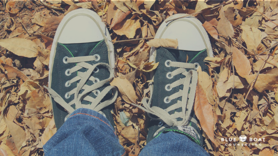 Teen's feet wearing black Converse. Teen therapy in Columbus, OH is available at Blue Boat Counseling in Worthington | 43085