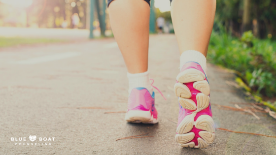 Woman's feet on a run. Exercise to help with anxiety. Blue Boat Counseling offers anxiety treatment Columbus, OH 43085.