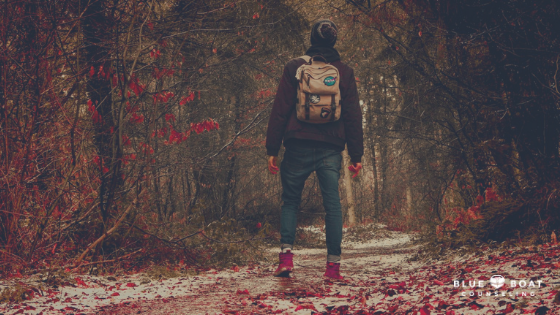 Teen boy with backpack in the woods. Treatment for teen depression in Columbus, OH is available at Blue Boat Counseling.