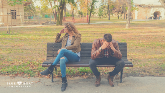 Couple fighting on a park bench. Marriage counseling & relationship help is available at Blue Boat Counseling Columbus, OH.
