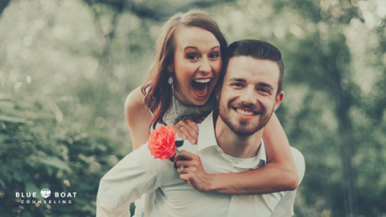 Happy couple smiling. Marriage counseling in Columbus, OH is available at Blue Boat Counseling to help your relationship.
