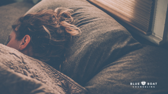Woman asleep in bed. Individual & marriage counseling in Columbus, OH is available at Blue Boat Counseling, 43085.