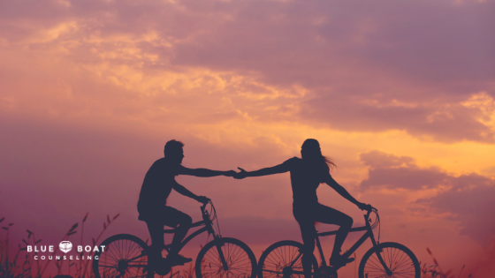 Couple riding bikes together. Blue Boat Counseling in Columbus, Ohio offers couples and marriage counseling, 43085.