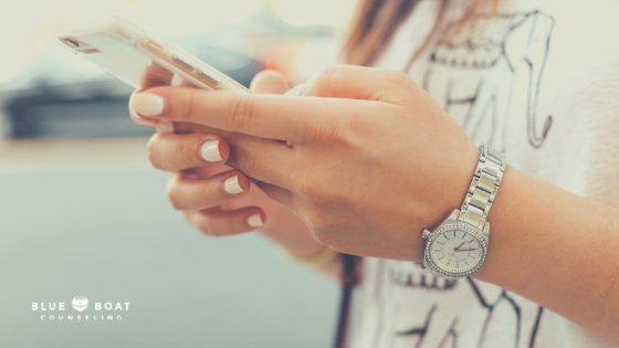 Teen girl on cell phone. Find depression counseling for a teenager in Columbus, OH at Blue Boat Counseling, 43085.