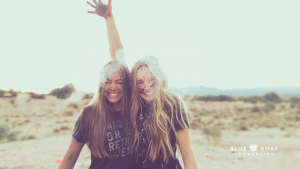 Teen girls laughing. Find Columbus counseling for teens with anxiety at Blue Boat Counseling in Worthington, Ohio 43085.