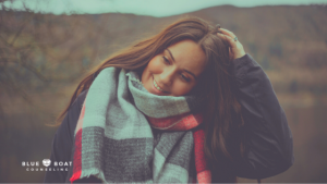 Girl with scarf smiling | Find anxiety counseling Columbus Ohio at Blue Boat Counseling in Worthington. | Columbus Counseling