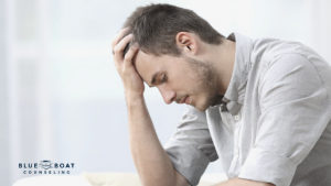 Sad man with head in hand | Find Columbus therapists for depression at Blue Boat Counseling in Worthington Ohio | 2020