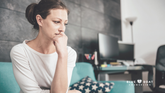 Sad woman on couch | Find depression therapist Columbus Ohio at Blue Boat Counseling in Worthington | 2020