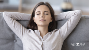 Girl with eyes closed on couch | Find Columbus OH counseling for depression, anxiety & more at Blue Boat Counseling | 2020