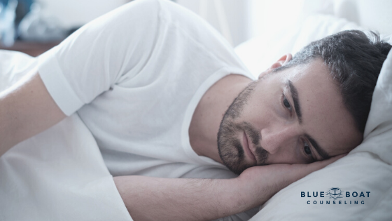 Man lying in bed | Find an anxiety & depression therapist Columbus Ohio at Blue Boat Counseling in Worthington | Feb 2020