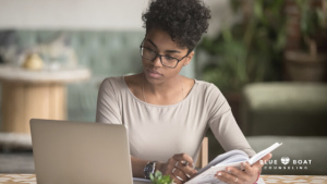Girl on a laptop | Find mental health therapist Columbus Ohio at Blue Boat Counseling | help for anxiety, depression & more