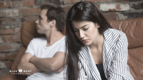 Unhappy couple on couch | Marriage counseling Columbus Ohio is available at Blue Boat Counseling | Relationship counseling