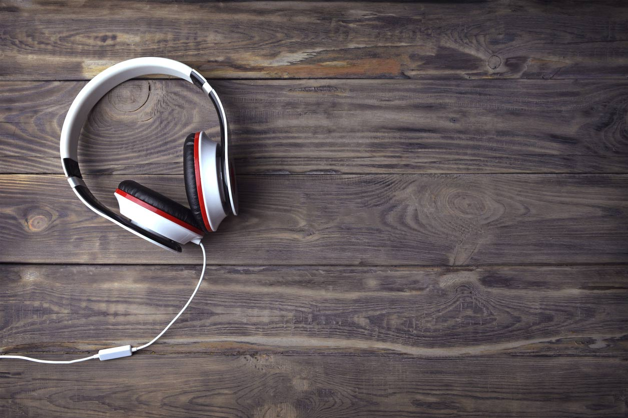 Headphones on table | Find mental health treatment in Ohio via online therapy or telehealth at Blue Boat Counseling | 43085