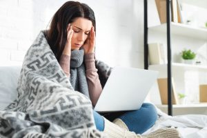 Stressed girl with laptop | Mental health therapist Columbus Ohio at Blue Boat Counseling offers online therapy for anxiety