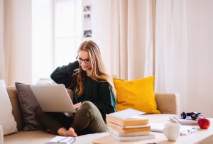 Girl on laptop | Find online counseling Ohio for mental health issues like anxiety and depression at Blue Boat Counseling