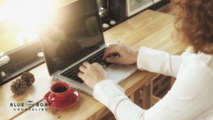 Woman on laptop | Depression therapist Columbus Ohio via online therapy at Blue Boat Counseling | Counseling Columbus 43085