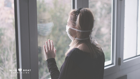 Girl with mask at window | Mental health online counseling Ohio is available at Blue Boat Counseling | Columbus OH Counseling