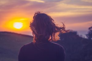 Girl watches sunset | Find depression therapist Columbus Ohio at Blue Boat Counseling | treatment for depression symptoms