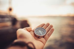 Hand holding compass | Find a mental health therapist Columbus Ohio at Blue Boat Counseling | Counseling Columbus Ohio