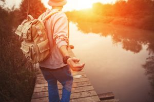 Man with backpack on dock | Find a mental health therapist Columbus Ohio at Blue Boat Counseling | anxiety & depression help
