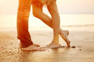 Couples' legs at the beach | Couples and marriage counseling available at Blue Boat Counseling | help for relationship issues