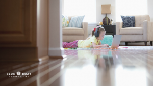 Little girl on computer | Marriage counseling Columbus Ohio | Online counseling in Ohio at Blue Boat Counseling | 43085