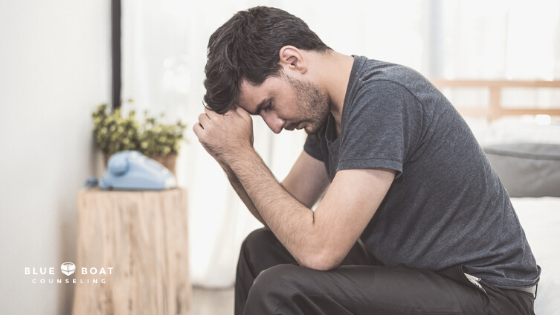 Worried man with head in hands | Stress & anxiety therapist Columbus Ohio | Blue Boat Counseling | online therapy | July 2020