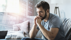 Man with head in hands | Find anxiety therapy Columbus at Blue Boat Counseling | online therapy Ohio | 43085 | August 2020