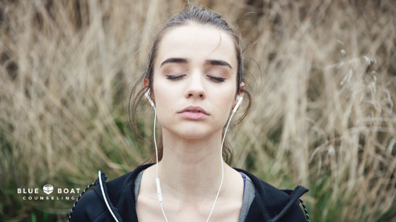 Girl with headphones deep breathing | Anxiety therapist in Columbus | Online counseling Ohio at Blue Boat Counseling | 2020