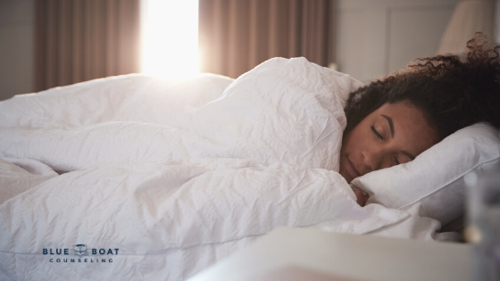Girl in bed sleeping | online therapy for anxiety | anxiety therapist in Columbus | Blue Boat Counseling | September 2020