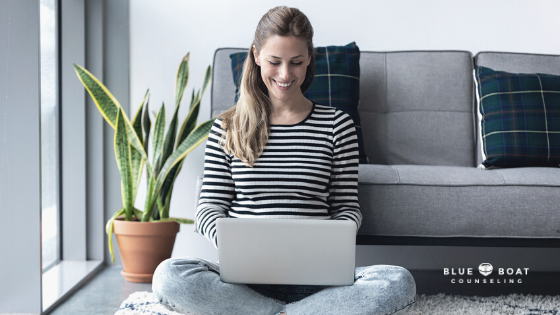 Girl on laptop smiling | anxiety therapy Columbus | Blue Boat Counseling | depression therapist in Columbus | Sept 2020