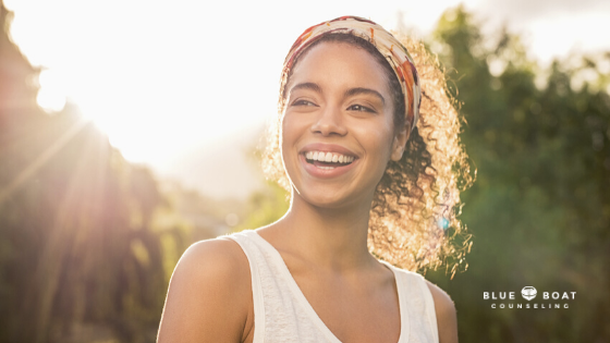 Woman smiling in sun   depression therapist in Columbus   online therapist Ohio   Blue Boat Counseling   October 2020