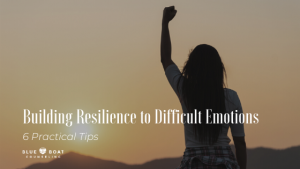 Woman with fist in the air | Building resilience to difficult emotions | anxiety therapist in Columbus | Blue Boat Counseling