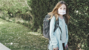 Girl with mask and backpack | teen therapist in Columbus | Blue Boat Counseling | online therapy for teens | November 2020