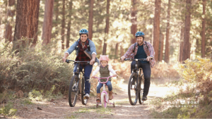 Dads & daughter biking | family therapist columbus | columbus counseling for teens | Blue Boat Counseling | December 2020