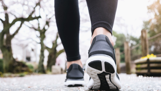 Woman's feet walking outside | Find anxiety therapy columbus at Blue Boat Counseling | help for your anxiety symptoms | 2021