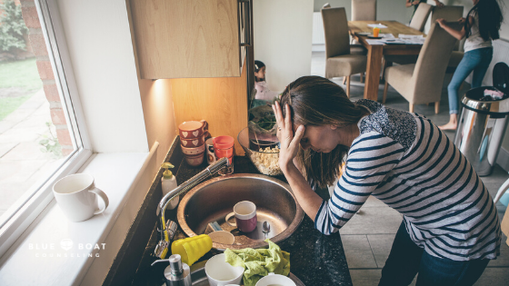Stressed mom bent over sink | coping with stress and parental burnout | anxiety therapist in columbus | Blue Boat Counseling