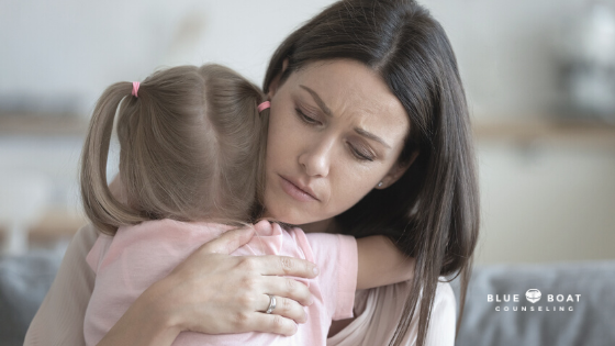 Mom hugging daughter | mental health therapist in columbus for stress and anxiety at Blue Boat Counseling | March 2021