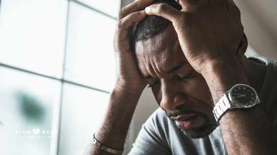 Man with head in hands | mental health effects of the pandemic | mental health therapist in columbus | Blue Boat Counseling