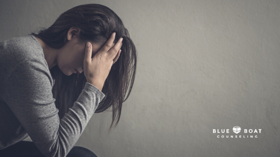 Girl with head in hands | depression counseling columbus ohio is offered at Blue Boat Counseling | May 2021 | 43085