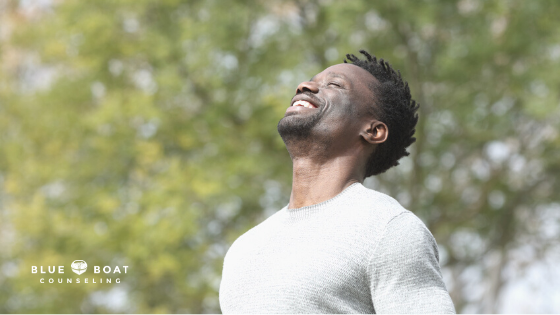 Man smiling outside | Find a depression therapist columbus ohio at Blue Boat Counseling | therapy columbus ohio | May 2021