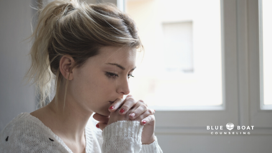 Sad girl with head in hands | depression counselor columbus ohio | find therapy columbus ohio at Blue Boat Counseling | 43085