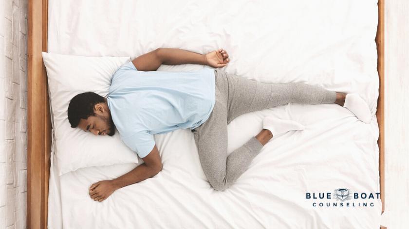 Man sleeping in bed   exercise helps sleep and mental health   mental health therapist columbus ohio in worthington   43085