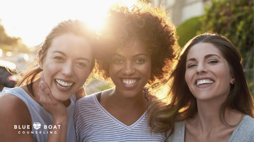 Three women friends smiling   therapy columbus ohio at Blue Boat Counseling for anxiety and stress management   2021